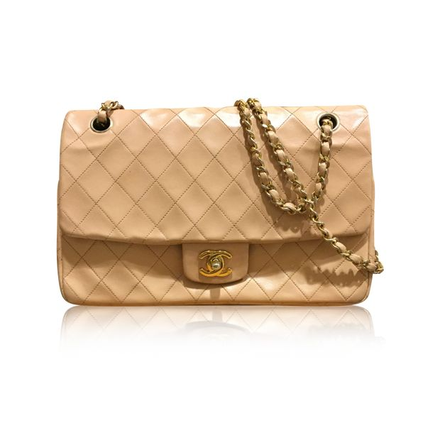 5947a8ce08b3 Vintage Beige Classic Flap Bag by CHANEL | StyleTribute.com