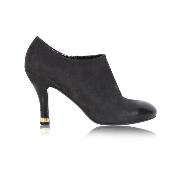 5d17de705b95 Black Leather Ankle Boots by LOUIS VUITTON   StyleTribute.com