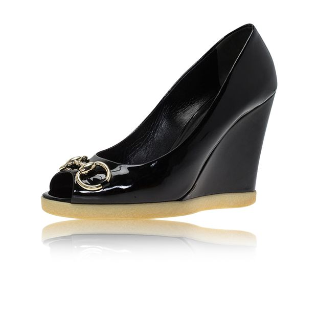 6d8850a791728 Black Patent Horsebit Peep Toe Wedge Pumps by GUCCI | StyleTribute.com
