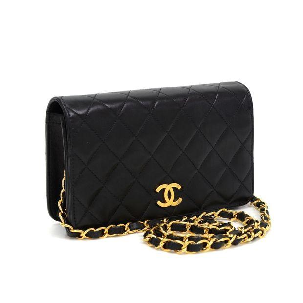 c76d0d3c4b5e04 Black Quilted Leather Shoulder Flap Mini Bag by CHANEL ...