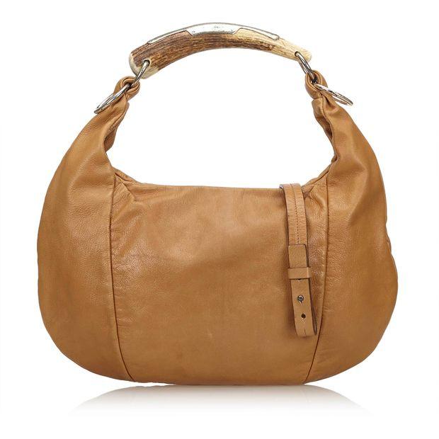 93e1dec11cc Leather Mombasa Bag by YVES SAINT LAURENT | StyleTribute.com