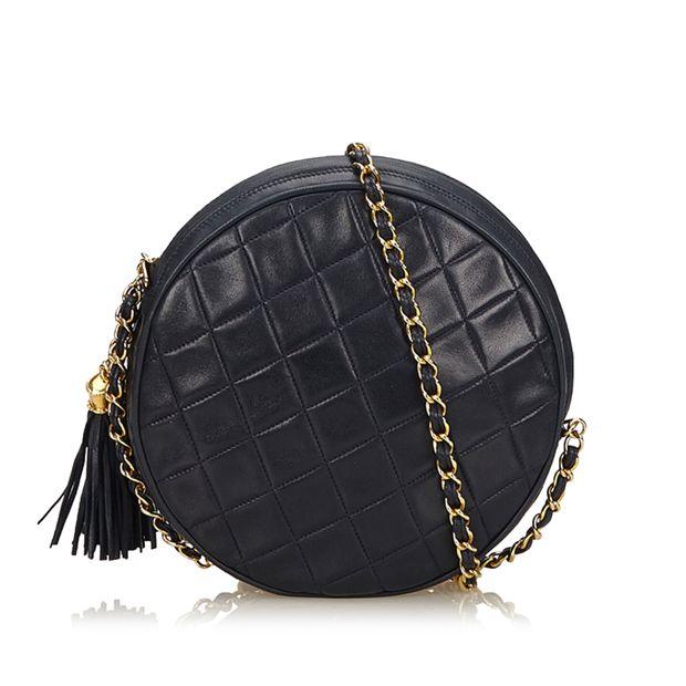 77062373efba Matelasse Tassel Lambskin Leather Bag by CHANEL   StyleTribute.com