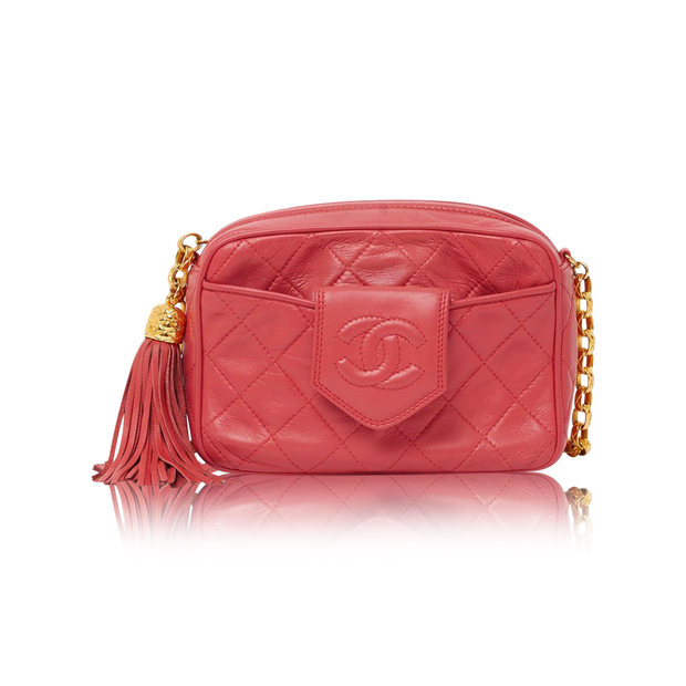 f7439e0fa434 Vintage Chanel pink camera bag with tassle by CHANEL | StyleTribute.com