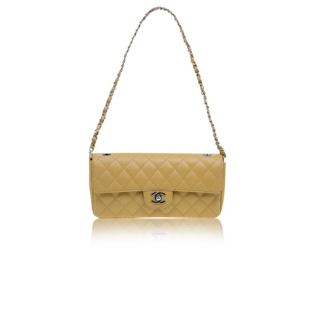 5f3bceacc543 Beige Quilted Lambskin East West Flap Bag by CHANEL | StyleTribute.com
