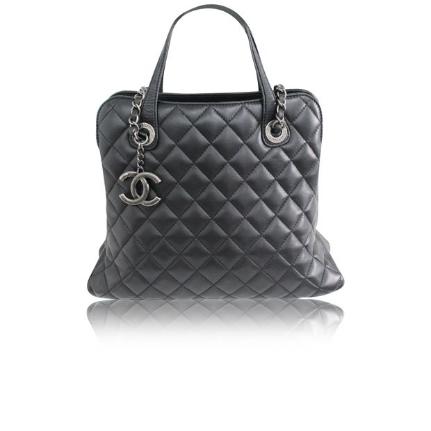 d997315825da Black Quilted Shoulder Bag With CC Logo by CHANEL | StyleTribute.com