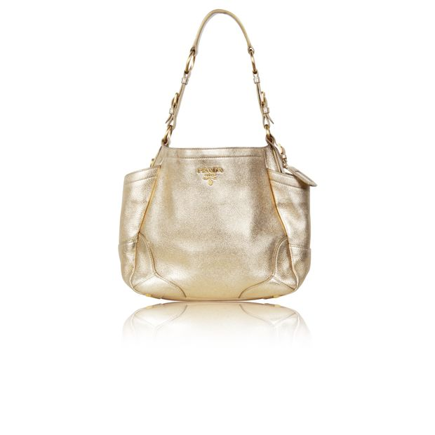 9e4e6a2998ab Gold Leather Handbag by PRADA | StyleTribute.com