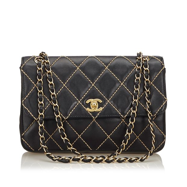 947842c0bda5 Surpique Lambskin Leather Flap Bag by CHANEL | StyleTribute.com