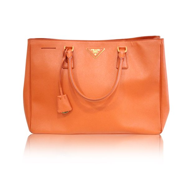 3aec911677f8 Saffiano Luxe Orange Tote Bag by PRADA | StyleTribute.com