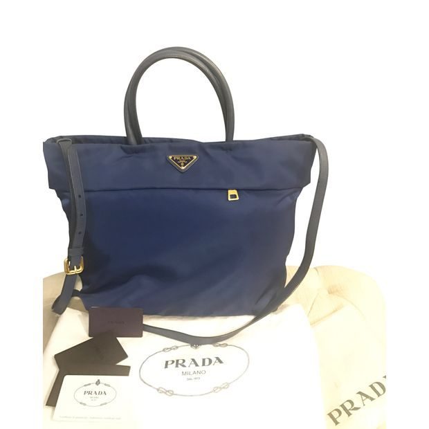 1381c4ab8642e2 Tessuto Saffiano Royal Blue Tote Bag by PRADA | StyleTribute.com