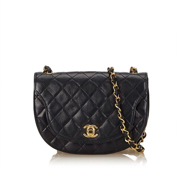 52b62fed870060 Matelasse Lambskin Leather Flap Bag by CHANEL   StyleTribute.com