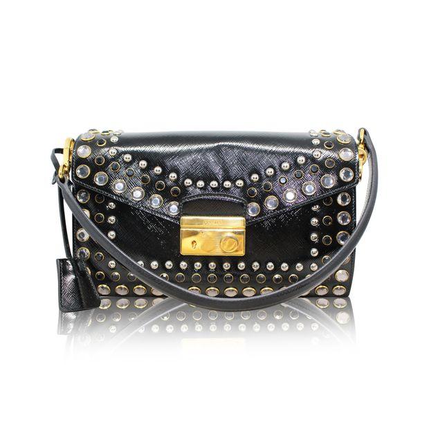 eb64b76779ba Patent Leather Vintage Stud Embellished Bag by PRADA | StyleTribute.com