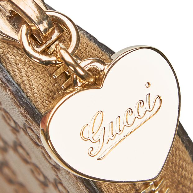 5464165120867c Guccissima Heart Coin Pouch by GUCCI | StyleTribute.com