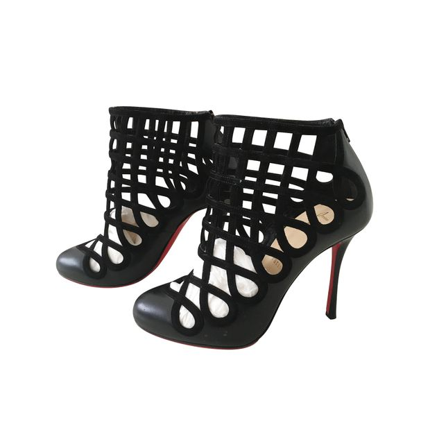 70015e2fde CHRISTIAN LOUBOUTIN Cajaboots Cutout Leather and Suede Ankle Boots 0  thumbnail