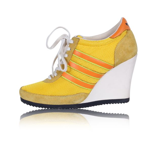 best website ccfde bf0e1 Adidas Yellow Wedge Sneakers by JEREMY SCOTT | StyleTribute.com