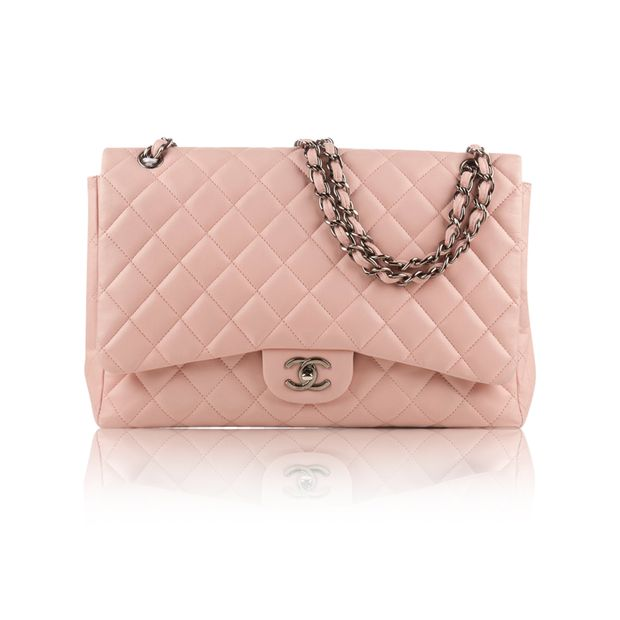 c1d585ab32c Light Pink Lambskin Jumbo Classic Flap Bag by CHANEL | StyleTribute.com