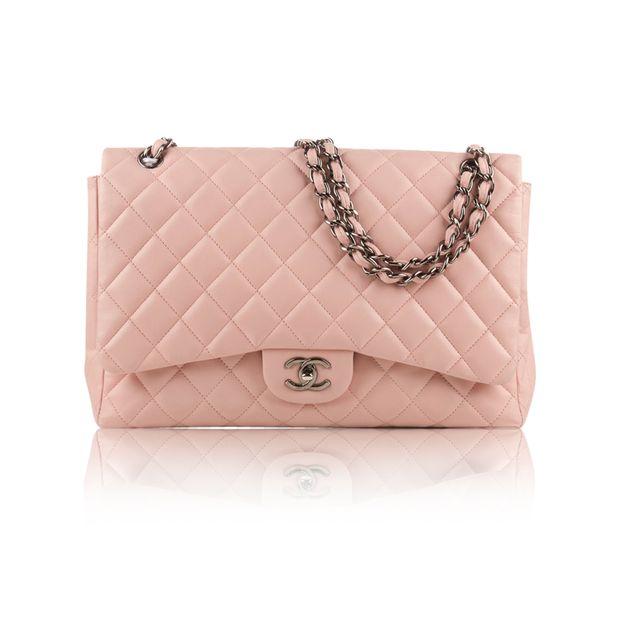 6520c1ed507e Light Pink Lambskin Jumbo Classic Flap Bag by CHANEL | StyleTribute.com