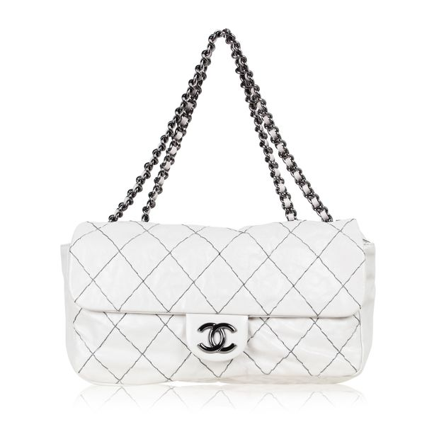 b62af286f85f57 CHANEL DOUBLE STITCH FLAP BAG by CHANEL | StyleTribute.com