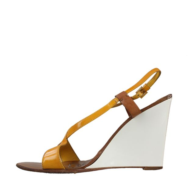 f0e3a53e19 Yellow Leather Wedge Sandals by LOUIS VUITTON | StyleTribute.com