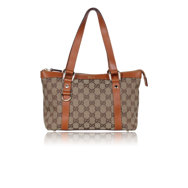 a452bb99f529 GG Monogram Canvas Small Tote Bag by GUCCI | StyleTribute.com