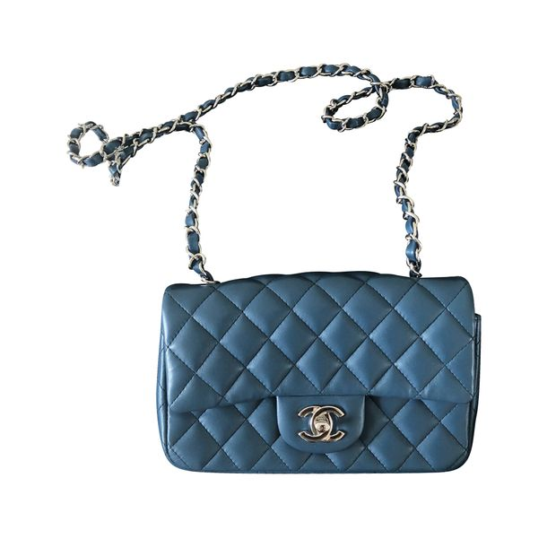 9d1760cc8d34 Mini Flap Bag In Blue by CHANEL | StyleTribute.com