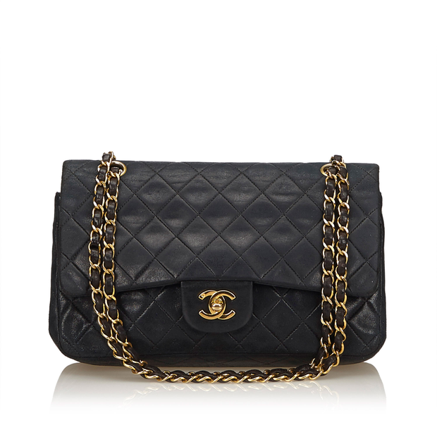 dd686e462216 Classic Medium Leather Double Flap Bag by CHANEL | StyleTribute.com