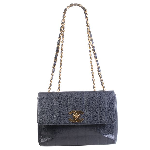 531ff36a4 Black Vintage Flap Bag by CHANEL | StyleTribute.com