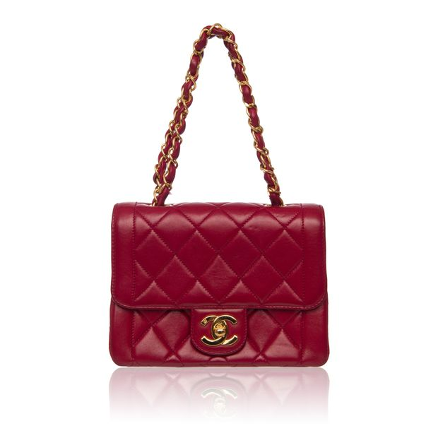 11698958424e3e Mini Quilted Giold Hardware Flapbag by CHANEL | StyleTribute.com