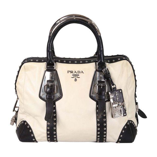 faa77f9ca2f0 Nappa Studded Trunk Bag by PRADA | StyleTribute.com