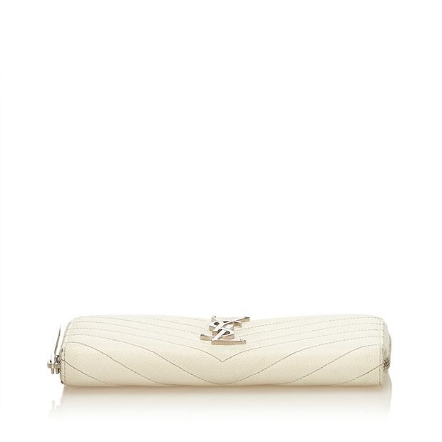 274544c1da3 Quilted Leather Long Wallet by YVES SAINT LAURENT | StyleTribute.com