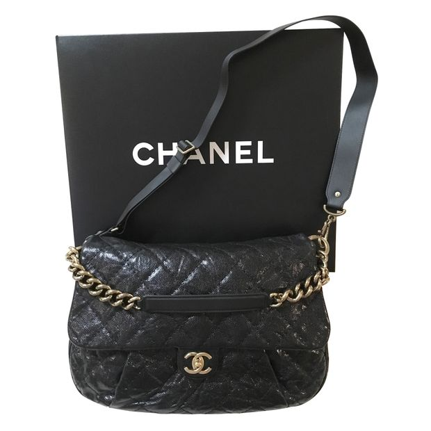 d7c2ceb2a8dcf7 Flap Bag In Black Leather by CHANEL | StyleTribute.com