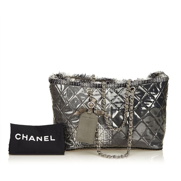 cd70fe127 Vinyl Funny Tweed Patchwork Tote by CHANEL | StyleTribute.com