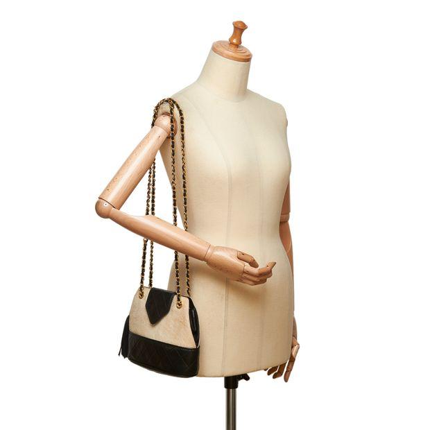 e06c55c24b00 Woven Raffia Chain Shoulder Bag by CHANEL | StyleTribute.com