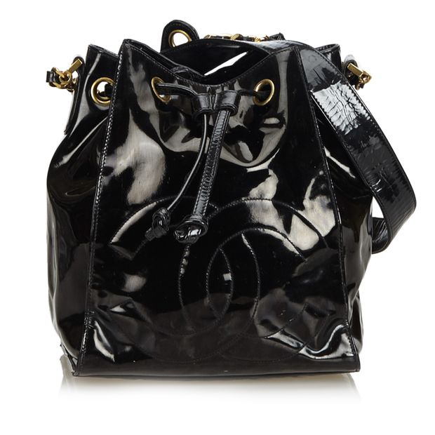 a630bf7d3276 Patent Leather Drawstring Bucket Bag by CHANEL | StyleTribute.com