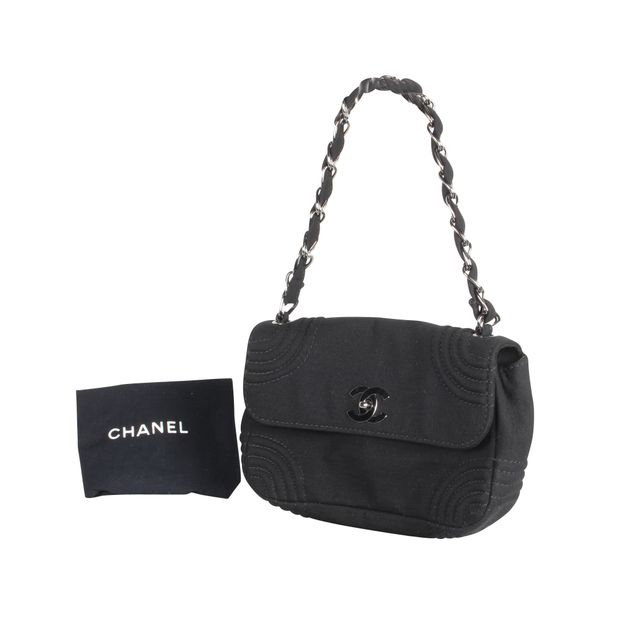 1ecf48486d1 Small Mademoiselle Fabric Flap Bag by CHANEL | StyleTribute.com