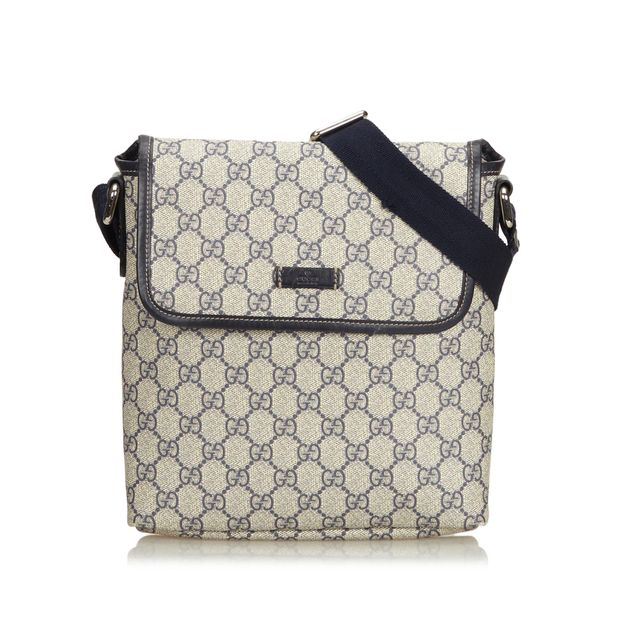 9b21aed87 Coated Canvas GG Supreme Crossbody Bag by GUCCI | StyleTribute.com