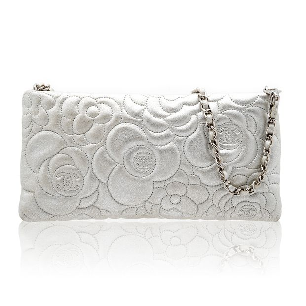 e9b98a79f73c31 Camellia Embossed WOC Clutch Bag by CHANEL | StyleTribute.com