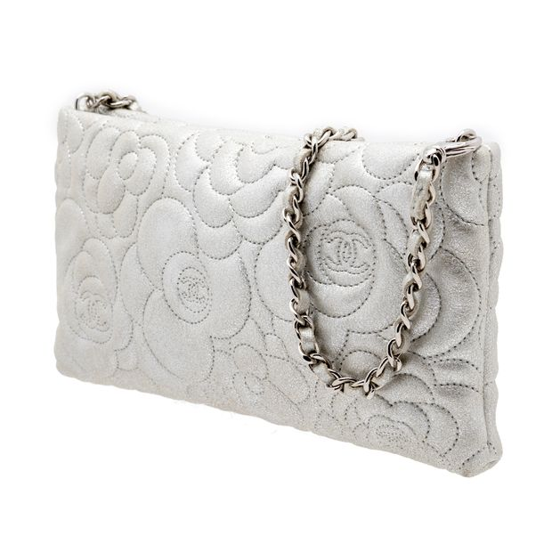 b354b7abed3ba4 Camellia Embossed WOC Clutch Bag by CHANEL | StyleTribute.com