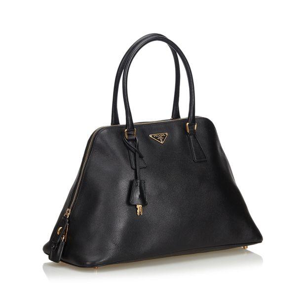 3b996c3fc02 Saffiano Leather Dome Handbag by PRADA | StyleTribute.com