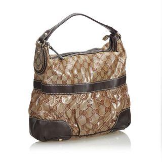 f9a86dc5959 GUCCI. GG Crystal Coated Canvas Mix Handbag