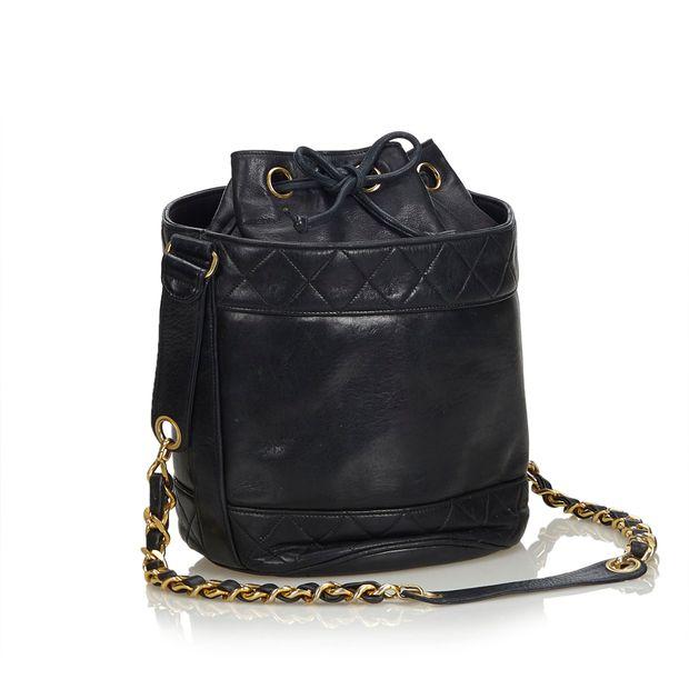 0494f4844b02 Matelasse Lambskin Leather Bucket Bag by CHANEL   StyleTribute.com