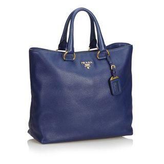 faa990f152 Prada Designer | StyleTribute.com